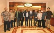 Indonesian UEC alumni and UEC mission members at the entrance of the hotel restaurant